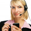 Beautiful hotline operator with cellphone in her hands isolated — Stock Photo #4903470