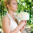 Redhead girl with a bridal bouquet of whit roses — Stock Photo