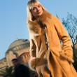 Beautiful blond girl wearing winter coat — Stock Photo