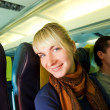 Happy passanger in aircraft — Stock Photo