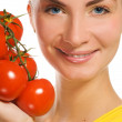 Beautiful girl with fresh tomatoes — Stock Photo #4903520