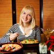 Beautiful blond girl in japanese restaurant — Stock Photo #4903553