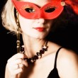 Girl with a red carnival mask - Stock Photo
