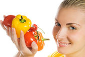 Beautiful young woman with fresh vegetables — Stock Photo