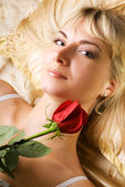 Young beautiful woman with red rose — Stock Photo