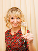 Beautiful girl with a glass of champagne — Stock Photo