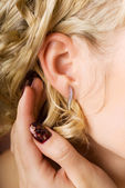 Woman's ear with diamond jewlery — 图库照片