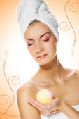 Beautiful young woman with aroma bath ball isolated on abstract — Stock Photo