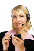 Beautiful hotline operator with cellphone in her hands isolated — Stock Photo