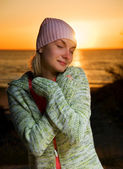 Young girl on the beach at sunset time — Stock Photo