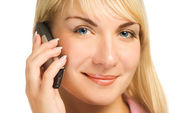 Lovely young girl talks on the phone — Stock Photo