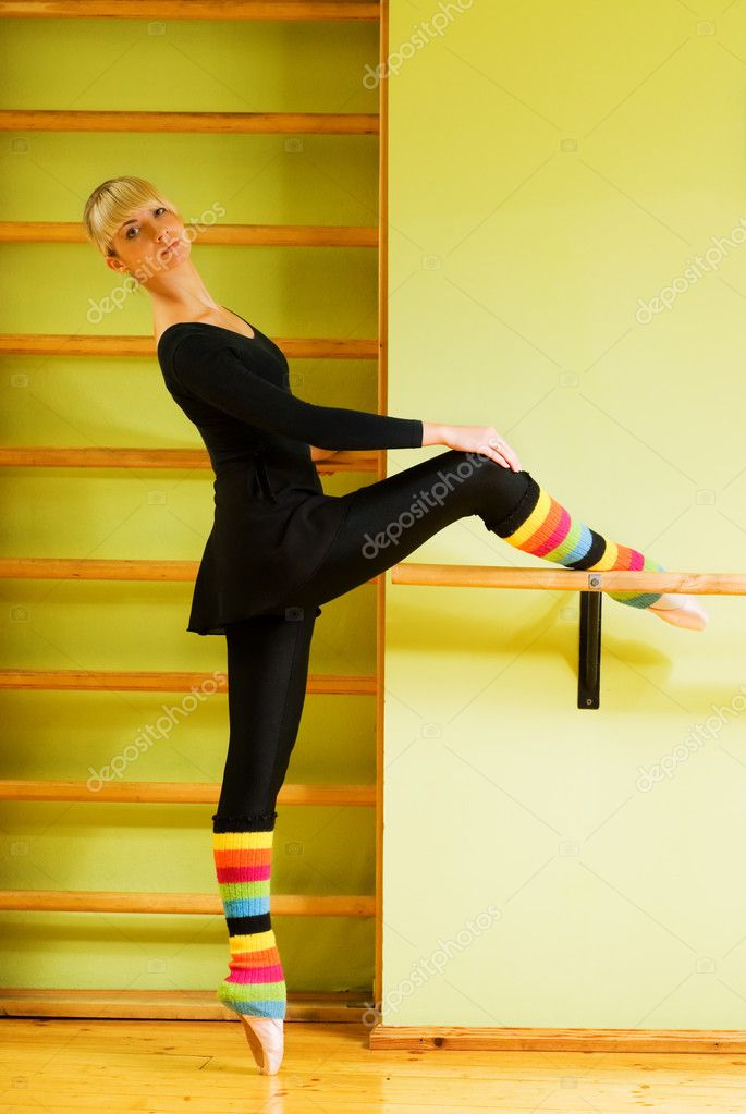 Ballet dancer doing exercise near the bar — Stock Photo #4903207