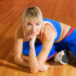 Stock Photo: Fitness trainer relaxing after exercise