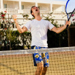 Tennis player screaming after winning a game — Stock Photo #4959034
