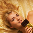 Stock Photo: Beautiful girl with chocolate craving close-up portrait