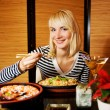 Beutiful blond girl in japanese restaurant — Stock Photo