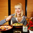 Stock Photo: Beutiful blond girl in japanese restaurant