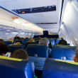 Stock Photo: Passengers in aircraft