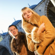 Attractive couple in lambskin coats — Stock Photo #4959101