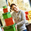 Teenager girl with gift boxes in a shop — Stock Photo #4959152