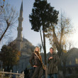 Attractive caucasian couple in front of famous Blue Mosque (Ista — Stock Photo