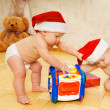 Royalty-Free Stock Photo: Two beautiful babies in Christmas hats
