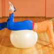 Fitness trainer on a fitball — Stock Photo