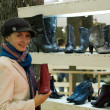 Beautiful girl in a shop buying winter boots — Stock Photo #4959317