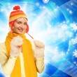 Beautiful girl in winter clothing on abstract background — Stock Photo #4959402