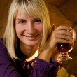 Close-up portrait of funny girl with a cup of tea — Stock Photo #4959473