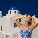 Beautiful blond girl on Santorini Island (Greece) — Stock Photo #4959478