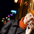Beautiful girl talks on the phone — Stock Photo