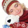 Beautiful girl in winter clothing with a polar bear toy — Stock Photo #4959642