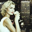 Beautiful blond girl drinks champagne on skyscraper in megapol — Stock Photo #4959655