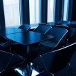 Modern conference room toned in blue - Stock Photo