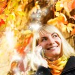 Happy girl talks to on the phone, abstract autumn background beh — Stock Photo