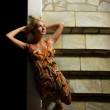 Sexy blond girl on a stairs — Stock Photo #4959971