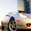 Sport car reflected in rendered water office building and clear — Stock Photo