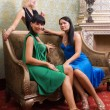 Royalty-Free Stock Photo: Three beautiful girls in luxury decorated room