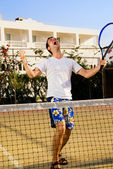 Tennis player screaming after winning a game — Stock Photo