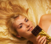 Beautiful girl with a chocolate craving close-up portrait — Stock Photo