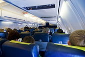 Passengers in aircraft — Stock Photo