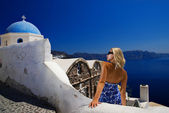 Beautiful blond girl on Santorini Island (Greece) — Stock Photo
