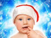 Adorable baby on abstract winter background — Stock Photo