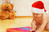 Adorable toddler in Christmas hat — Stock Photo