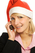 Business woman in Chrismtas hat talks on the phone. Isolated on — Stock Photo