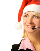 Beautiful phone operator in Santa hat — Stock Photo