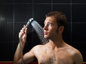 Handsome man in a shower — Stock Photo