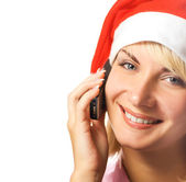Christmas girl talks on the phone. Isolated on white background — Stock Photo