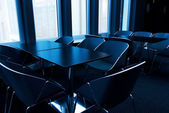 Modern conference room toned in blue — Stock Photo
